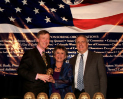 Receiving the MLK Award from current Colorado Governor John Hickenlooper and former Governor Bill Ritter